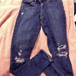 Levis 711 Distressed denim skinny jeans
